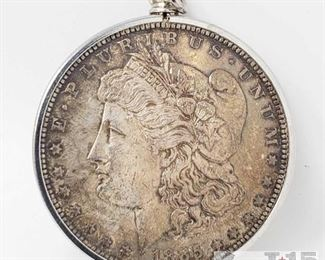 401:  Morgan Silver Dollar weighs approx 29.5g New Orleans Mint