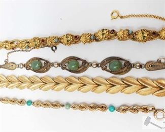 """702:  Trifari Bracelet, Florenza Bracelet with Jewels, Sorrento Bracelet and a 12k Gold Filled Bracelet Trifari Bracelet, Florenza Bracelet with Jewels, Sorrento Bracelet and a 12k Gold Filled Bracelet measures approx from 7"""" to 8"""" weighs approx 79.5g"""