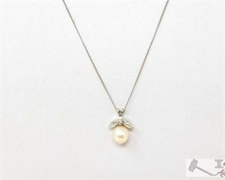 """756:  10k Gold Necklace with Diamond and what appears to be Fresh Water Pearl Pendant 10k Gold Necklace with Diamond and what appears to be Fresh Water Pearl Pendant weighs approx 2g measures approx 9.5"""""""