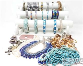 757:  Miscellaneous Jewlery and iPhone charging doc Here's a gorgeous mixed lot of colorful jewelry, mostly beaded or painted bracelets in beautiful colors. Gold, silver, and rhinestone costume pieces are also included. A nice little set of wardrobe accessories including an iPhone charging dock!
