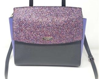 901:  Kate Spade Hand Bag What a gorgeous new leather Kate Spade purse! This one is gray with lavender sides, glitter accent, and solid black front and back sections with black handle and shoulder strap. VERY nice!!