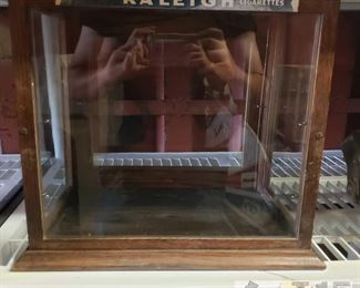 """6601:  Vintage Raleigh cigarettes display case This is a pretty rare and unique vintage Raleigh cigarettes display case with stained wooden frame and glass panels measures roughly 10.5"""" X 14.5"""" X 16 This display case is approx. 14.75"""" tall x 16.50"""" x 11"""""""