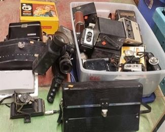 6607: Various vintage cameras Vintage camera collectors… CHECK IT OUT! This lot features a large variety of vintage cameras, camera parts, flashes, straps, cases, and accessories. **see next lot for more**