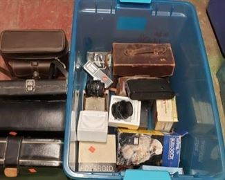6608:  Various vintage cameras, lenses, and more! This lot features more vintage cameras, lenses, camera parts, flashes, straps, cases, and accessories. Approx. 6 cases, 1 macro lense, 1 kalt lense, and more