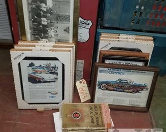 6613: Vintage Automotive wall art and maps SUPER COOL LOT for vintage car buffs!! Featuring several pieces of vintage automotive art new in original boxes! Several framed certificates, authenticity of artifacts, framed news and advertisement clippings, Route 66 memorabilia, a vintage northeastern US map, directory of motor courts and cottages, AAA tour book.