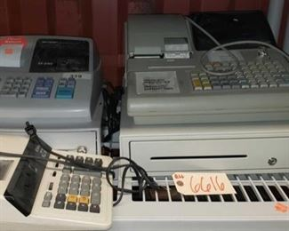 """6616: 3 cash registers Shown here are two cash registers with keys, and a professional desk calculator. Larger cash register is a Royal alpha 9155C series cash register with 16 character name or description, tax table look ups, 1600 price check look ups, heavy duty alpha numeric 2-station printer with bar code scanner and PLU set up programming. Connects of PC to work with business software. The smaller cash register marked 319 is a Sharp model XE-A102 electronic machine small in size but high performance, simple to use, easy to program, efficient with large 14-mm display, high contrast LED screen, eight departments, four clerk numbers, auto tax system, flash report. Locking. Accepts 2.25"""" paper rolls. A Canon electronic calculator with red and black ribbon"""