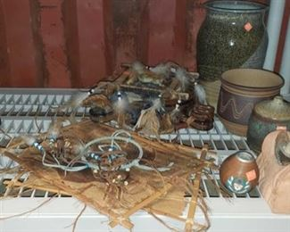 6625: Various native decor Native American home décor! Handmade pieces include a beautiful blue feather dream catcher, a pottery incense bowl, some jewelry pieces, antelope wall hangings, terra cotta candle holder, two small pots, a very decorative drum flask, and more!