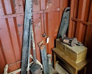 6632:  Antique Yard Tools with Small Desk and Wood Box Shown here are vintage yard tools still in useful working order, a water well pump handle, a wooden box hand made in vintage hardwood, a branding iron, saw blades.