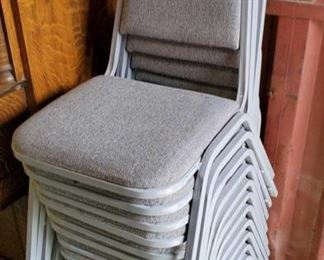 6646:  Twelve Cushioned Gray Chairs In excellent condition! Here are 12 nice stackable steel construction conference chairs with gray padded backs and seats. Great to have on hand for large gatherings!