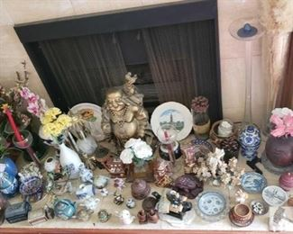 8525: Lot of Various Knick Knacks, Buddha Statue, Vases, Trinkets, and More.. Here's the windfall lot for nick knacks and fine shelf trinkets. LOTS to look at and see, many collectables shown here including ceramic plates, hand painted bowls, vases, figurines, boxes, buddhas, and more.