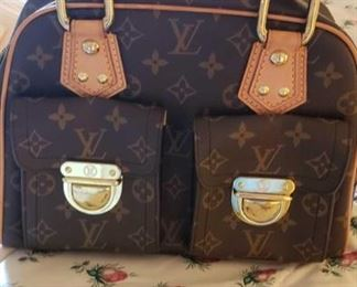 8705: Not Authenticated Louis Vuitton handbag This apparent Louis Vuitton handbag has not been authenticated but resembles models produced in France by this designer. Hardware and clasps appear to be good quality. Leather handles, brass hardware, and natural cowhide leather trim.
