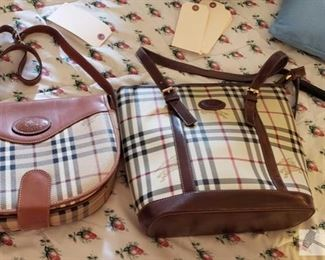 8706:  Not Authenticated Burberry's handbags Not authenticated but these bags resemble Burberry shoulder bags. Both in signature Burberry Novacheck plaid, these purses feature nylon and canvas with leather trim with center compartments and zip closures.