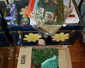 8904:  Trunk and Box Full of Christmas Decorations This is a FANTASTIC Christmas lot! Full of new and like-new items including decorations, hand towels, garland, gift bags, tags, and wrap… best part of all is the awesome vintage style trunk that most of these items are loaded in! Great lot for the holidays!