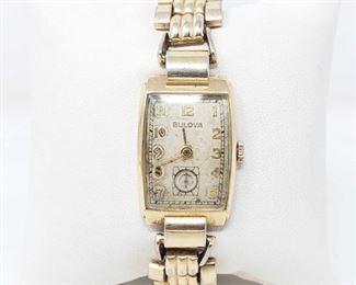 816:  10k GF Bulova Watch 10k GF(goldfilled) Bulova Watch measures approx 20mm. Does tick.