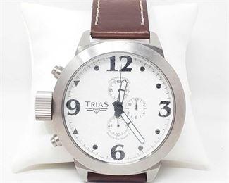 818:  Trias Wrist Watch Trias Wrist Watch measures approx 55mm. Does tick.