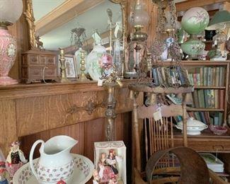 Oak mantle, books, lamps trampart