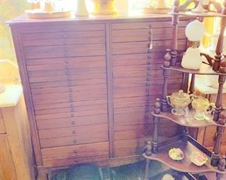 Cabinet with loads of drawers,( sheet music cabinet?) clock