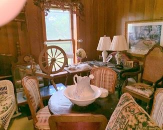 Upholstered pieces, at least 3 spinning wheels, and many many bowl and pitchers