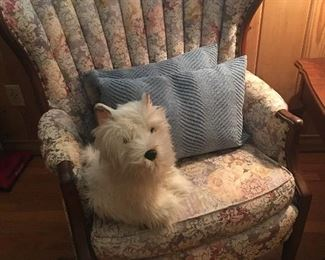 Very beautiful antique wing back chair in excellent condition.  The little doggie is a stuffed toy from FOA Schwartz