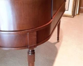 Rare Stunning Sligh Two-Tier English writing desk with leather top writing surface furniture of Holland, Michigan. The brass lock hardware accents the 9 drawers with original brass pulls. The curved back is beautifully finished so the desk can free-stand in a room. Lesser size listing as follows on another site...not same desk but same maker. https://www.1stdibs.com/furniture/tables/desks-writing-tables/sligh-walnut-curved-front-desk-leather-top/id-f_1141858/?gclid=Cj0KCQjwv8nqBRDGARIsAHfR9wCSzbjfRooPw17h1GRU9-mS9jtoJT_NI9xHfYXxVB7voUHKdIeTFxgaAhgsEALw_wcB&gclsrc=aw.ds
