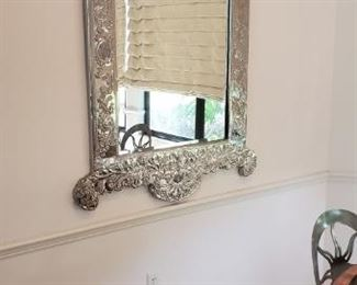 Silver framed focal piece mirror