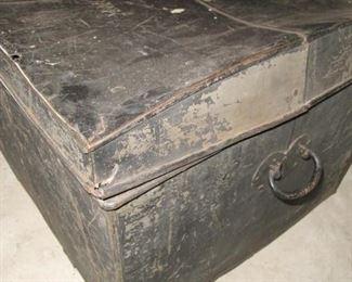 Tin trunk.