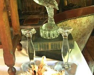 Close-up of pelican, candlesticks, vintage/antique books