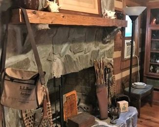 Vintage print, snowshoes, fireplace equipment, brown jug, needlepoint rug, more