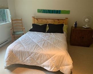Queen size beds including this rustic pine one.  Down comforters and other bedding throughout home.