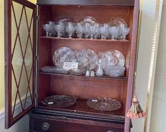 China cabinet full of glass ware from The Sandwich Glass Co. made by Duncan Miller