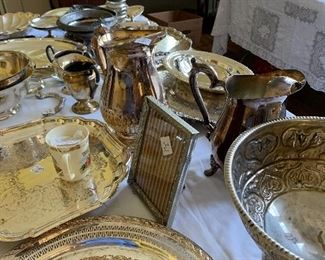 Lots of lovely silver serving pieces...trays, bowls, dishes, picture frame, nose gay, teapots and more!!
