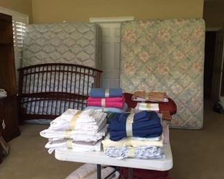 linens, nice guestroom queen beds, bookshelves, comforters