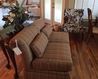 nice upholstered furniture, foyer/sofa table, cowhide chair