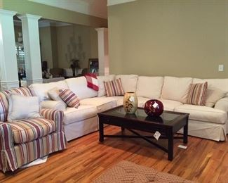 Beautiful sectional, club chairs,  display case coffee table, decor