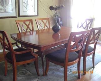 """Basset dining room table with four chairs and two arm chairs.  Black fabric in good condition.  Table is wider than some and is 74"""" x 44"""".  Beautiful condition."""
