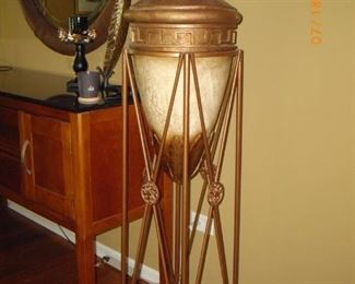 """Large accent piece is a jardinere that is 62"""" tall and 14"""" in diameter."""