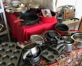 SUCH A LARGE SUPPLY OF POTS AND PANS, BAKERS, ETC., THAT WE HAD TO PUT THEM OUT IN THE GARAGE.