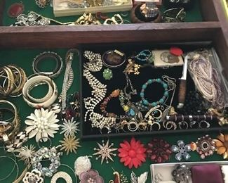A large supply of costume jewelry.  Broaches, rings, bracelets.