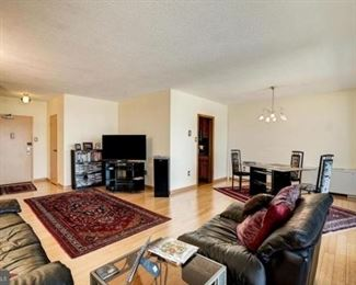 living room: leather couch, leather love seat, two glass end tables, lamp, speakers, and stereo (TV and TV stand not for sale),  candle holders, Persian wool rug,  glass dining room table with 4 contemporary chairs, Persian wool rug