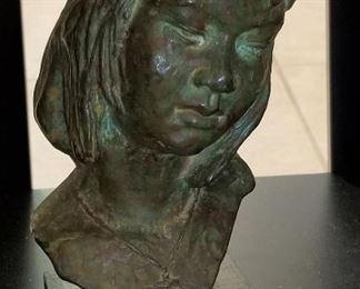 Sculpture of a little girl bust.