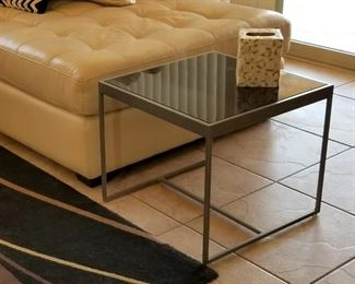 One of the black glass tables that can slide under the coffee table.
