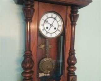 Smaller of the two German antique wall clocks
