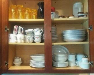 2 sets of dinnerware and glasses