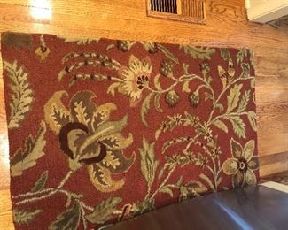 There are two of these small rugs.  Nice and thick.  It is in front of a refrigertor (for size reference).