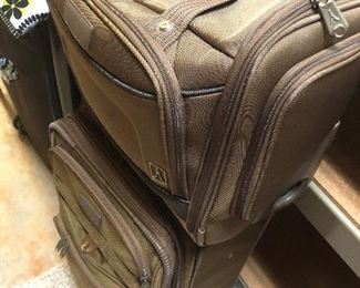 Two pieces of matching Travelpro luggage.