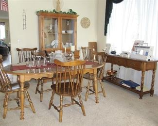 Maple table with 6 chairs and a leaf with a matching petite china cabinet