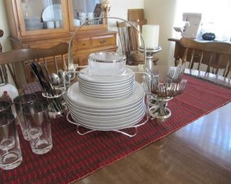 Elegant silver rimmed dinnerware service for eight