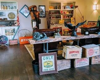 vintage advertising signs, vintage fishing poles tackle, guns, beer crates and more
