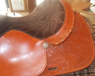"Beautiful hand tooled leather 15"" seat."