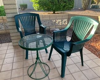 Plastic green chairs and small table